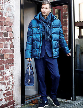 How to wear: blue puffer jacket, blue wool suit, navy suede slip-on sneakers, navy leather briefcase