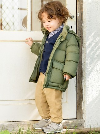 How to wear: olive puffer jacket, navy and white horizontal striped sweater, navy cardigan, tan trousers