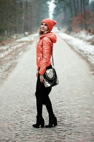 How to wear: red puffer jacket, black knit sweater dress, black leather ankle boots, black embellished leather crossbody bag