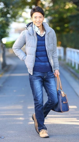 How To Wear Blue Jeans With a Blue Sweater For Men: A blue sweater and blue jeans are robust sartorial weapons in any modern gent's sartorial collection. Introduce a pair of beige suede desert boots to the equation to completely spice up the look.
