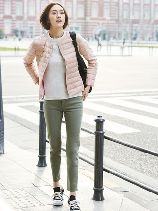How to wear: pink puffer jacket, white sweatshirt, olive jeans, black and white canvas low top sneakers