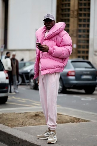 Track Suit Outfits For Men: This pairing of a track suit and a pink puffer jacket spells comfort and casual cool. For something more on the daring side to complement your outfit, opt for beige athletic shoes.