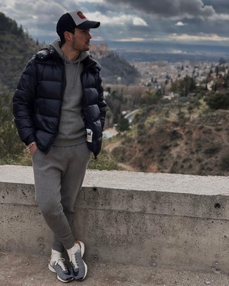 Puffer Jacket Outfits For Men: This pairing of a puffer jacket and a grey track suit is on the casual side but will guarantee that you look sharp and incredibly dapper. For something more on the daring side to round off your look, add navy and white athletic shoes to the mix.
