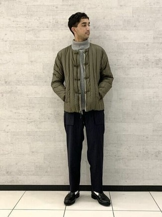 Grey Wool Turtleneck Outfits For Men: This laid-back combination of a grey wool turtleneck and black vertical striped chinos is a real lifesaver when you need to look great in a flash. Introduce a pair of black leather loafers to this outfit for an extra dose of style.