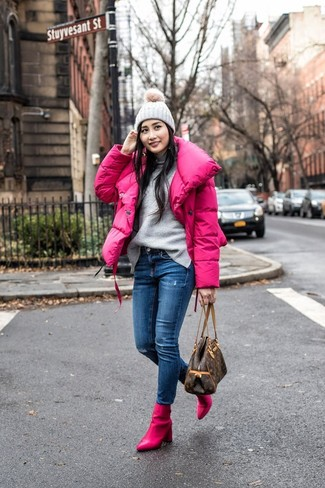 How to wear: hot pink puffer jacket, grey turtleneck, blue ripped skinny jeans, hot pink leather ankle boots