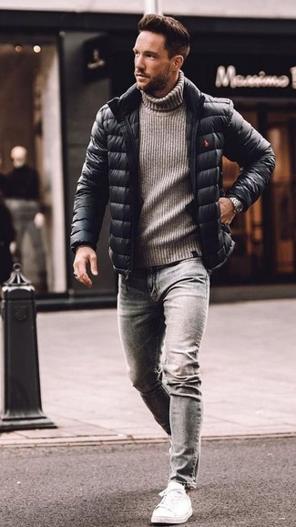 How to wear: black puffer jacket, grey knit wool turtleneck, grey skinny jeans, white leather low top sneakers