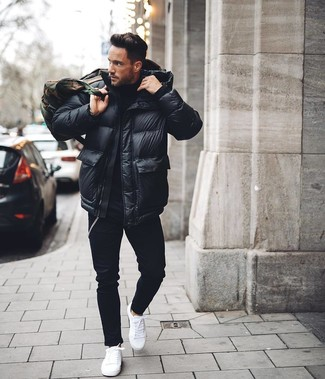 How to Wear a Black Puffer Jacket For Men: A black puffer jacket and black skinny jeans are a nice ensemble that will easily take you throughout the day. Consider white low top sneakers as the glue that brings your look together.