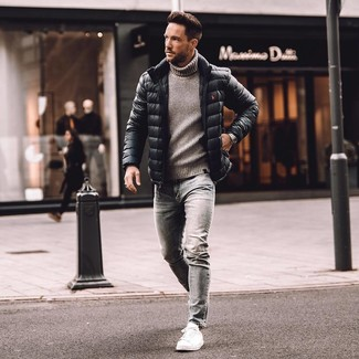 How to wear: black puffer jacket, grey knit turtleneck, grey skinny jeans, white leather low top sneakers