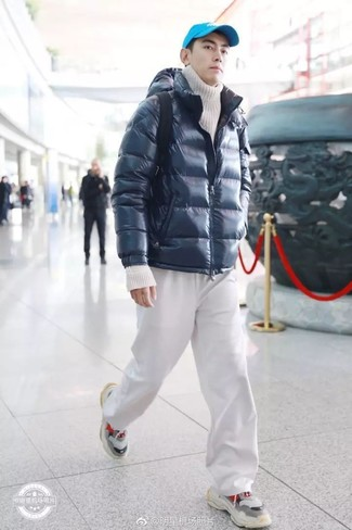 How to wear: navy puffer jacket, white knit turtleneck, white sweatpants, grey athletic shoes