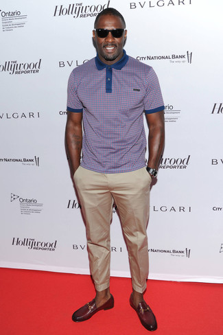 Idris Elba wearing Purple Check Polo, Beige Chinos, Burgundy Leather Loafers, Black Leather Watch