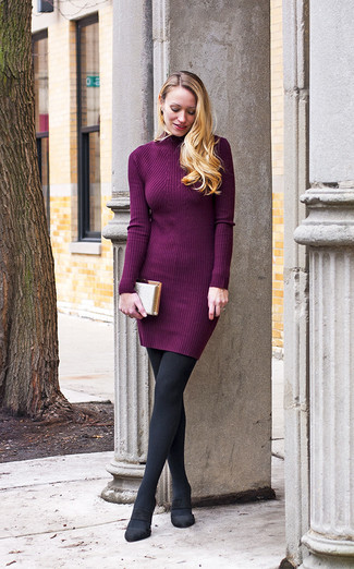 Nail glam in a purple sweater dress. For the maximum chicness grab a pair of black suede pumps.