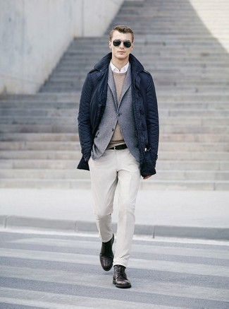 Belt Outfits For Men: For something more on the casually cool end, consider this combo of a navy raincoat and a belt. Channel your inner Ryan Gosling and complement your outfit with a pair of dark brown leather casual boots.