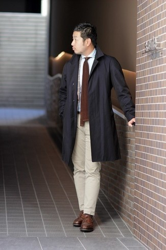 Tie Outfits For Men: You'll be surprised at how easy it is for any gent to pull together this casually smart look. Just a black raincoat combined with a tie. Complete your ensemble with brown leather derby shoes and the whole look will come together quite nicely.