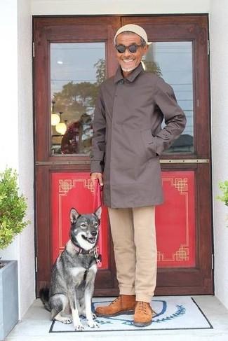 How to wear: dark brown raincoat, beige chinos, tobacco suede work boots, beige beanie