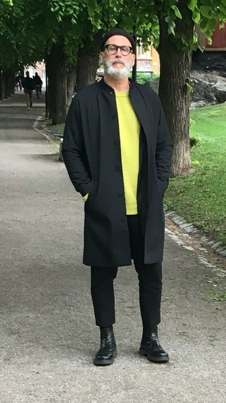 How to wear: black raincoat, green-yellow crew-neck sweater, black chinos, black leather chelsea boots
