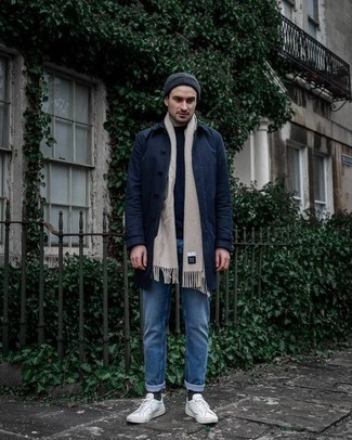 How to Wear a Navy Beanie For Men: This combination of a navy raincoat and a navy beanie delivers comfort and practicality and helps you keep it simple yet contemporary. Dial down the casualness of your ensemble by finishing with white canvas low top sneakers.
