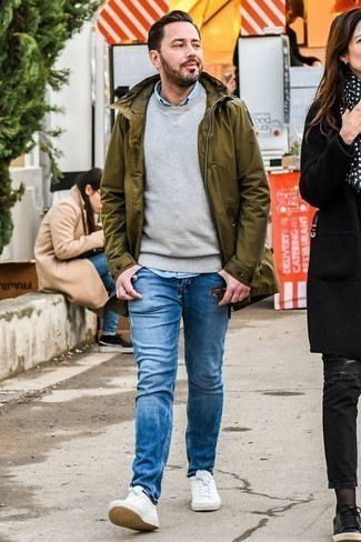 How to Wear a Light Blue Chambray Long Sleeve Shirt For Men: A light blue chambray long sleeve shirt and blue ripped jeans are a savvy ensemble to have in your closet. Why not add white leather low top sneakers to this ensemble for an extra touch of style?