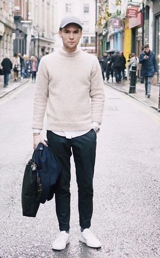 How to Wear a Black Canvas Tote Bag For Men: You'll be surprised at how extremely easy it is for any gentleman to put together an off-duty getup like this. Just a navy raincoat and a black canvas tote bag. Finish off with white canvas low top sneakers to instantly jazz up the look.