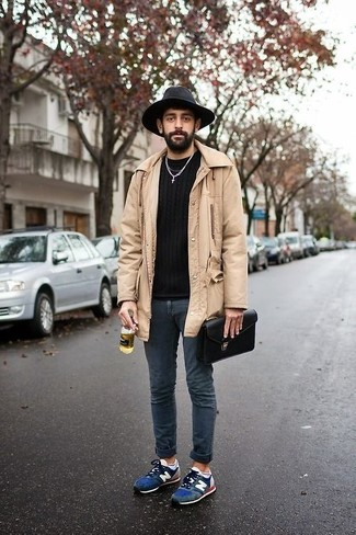 How to wear: beige raincoat, black crew-neck sweater, navy skinny jeans, navy suede athletic shoes