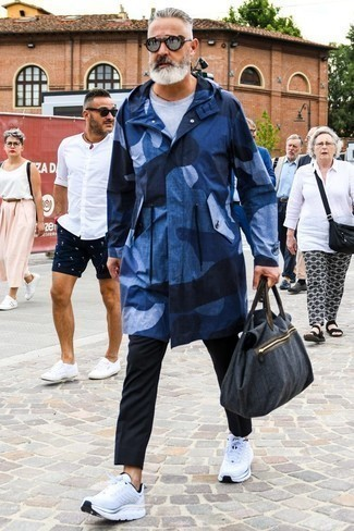How to Wear a Holdall For Men: If the situation allows casual urban styling, you can easily wear a navy raincoat and a holdall. White athletic shoes are the perfect companion to your outfit.