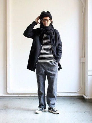 How to Wear a Black Scarf For Men: A black raincoat and a black scarf are the kind of a no-brainer casual look that you so awfully need when you have zero time. Rounding off with a pair of navy and white canvas low top sneakers is a fail-safe way to introduce a bit of flair to this getup.