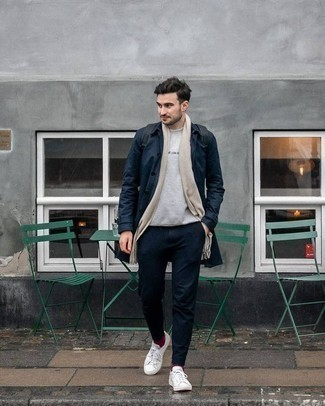 Beige Scarf Outfits For Men: Make a navy raincoat and a beige scarf your outfit choice to create an extra stylish and off-duty outfit. A pair of white canvas low top sneakers immediately dials up the style factor of any outfit.