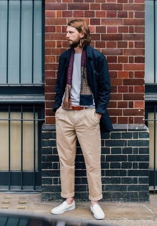 How to Wear a Tobacco Leather Belt For Men: If you don't take fashion too seriously, go for off-duty style in a navy raincoat and a tobacco leather belt. Wondering how to complement your outfit? Wear a pair of beige canvas slip-on sneakers to bump it up.