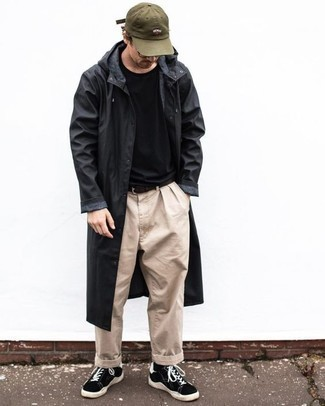 Black and White Suede Low Top Sneakers Outfits For Men: A black raincoat and beige chinos are essential in any man's functional casual arsenal. A pair of black and white suede low top sneakers is the glue that will bring your ensemble together.