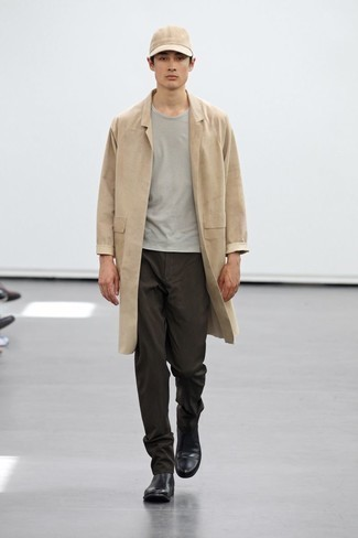 Men's Outfits 2020: This laid-back pairing of a tan raincoat and dark brown chinos is a solid bet when you need to look stylish but have no extra time. Complement this ensemble with a pair of black leather chelsea boots to take things up a notch.
