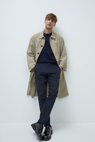 Men's Outfits 2020: A beige raincoat and navy chinos are a great pairing to take you throughout the day. Black leather derby shoes are an effortless way to power up your outfit.