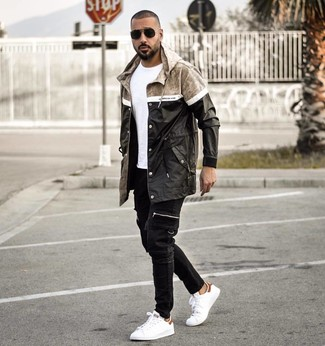 How to Wear Black Jeans For Men: A black raincoat and black jeans worn together are a smart match. White leather low top sneakers are a smart pick to complete your outfit.