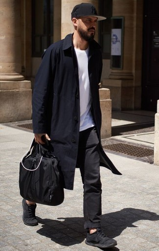 How to Wear Black Jeans For Men: Why not wear a navy raincoat with black jeans? As well as very functional, both items look good teamed together. Black athletic shoes will give an element of stylish nonchalance to an otherwise all-too-safe look.