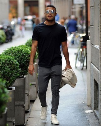 How to Wear Charcoal Skinny Jeans For Men: We all look for practicality when it comes to style, and this relaxed casual combination of a beige raincoat and charcoal skinny jeans is a good illustration of that. On the shoe front, this look pairs perfectly with white canvas low top sneakers.