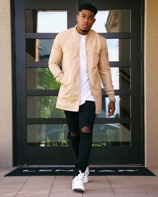 Black Jeans Spring Outfits For Men: This combination of a tan raincoat and black jeans is uber stylish and creates instant appeal. White leather low top sneakers are a wonderful pick to finish off this ensemble. An amazing example of transitional style, this getup is ideal this spring.