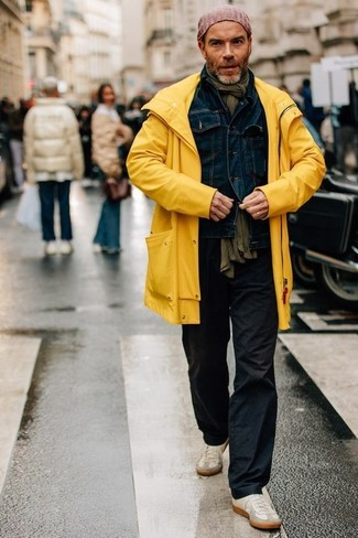 How to wear: yellow raincoat, navy denim jacket, black chinos, beige suede low top sneakers