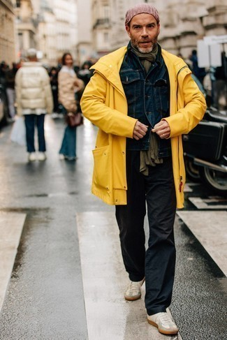 White and Red Leather Low Top Sneakers Outfits For Men: A mustard raincoat and black chinos will allow you to showcase your stylish self. A pair of white and red leather low top sneakers is very fitting here.