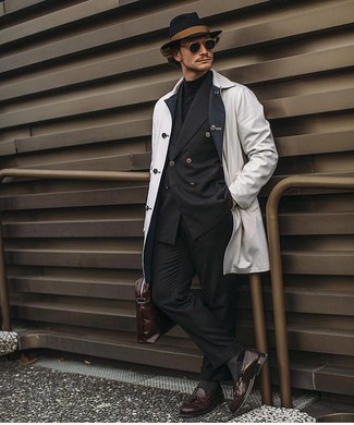 How to wear: white raincoat, black double breasted blazer, black turtleneck, black dress pants