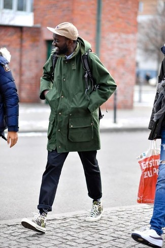 An olive raincoat and navy chinos are both versatile essentials that will give your outfits a subtle modification. Mix things up by wearing olive camouflage high top sneakers. With the departure of winter comes a sense of spring renewal and the need for a cool getup just like this one.
