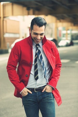 How to wear: red raincoat, white and navy vertical striped dress shirt, blue skinny jeans, navy vertical striped tie