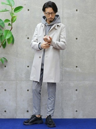 Grey Hoodie Casual Outfits For Men: Rock a grey hoodie with grey chinos to achieve a truly stylish and current casual outfit. Want to tone it down when it comes to footwear? Complete your getup with a pair of black athletic shoes for the day.