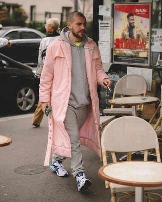 Men's Looks & Outfits: What To Wear In a Relaxed Way: A pink raincoat and grey sweatpants make for the ultimate laid-back style for any gent. If you need to effortlessly tone down this ensemble with shoes, why not introduce white and navy athletic shoes to your look?