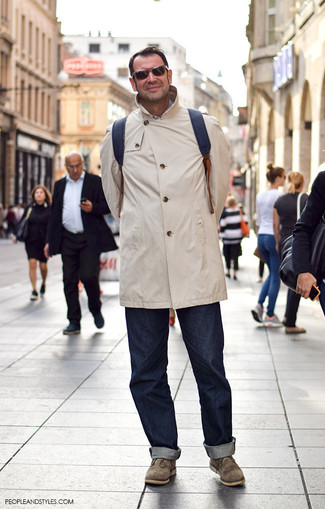 If you don't like getting too predictable with your looks, pair a beige raincoat with Levi's 511 Slim Fit Jeans. Polish off the ensemble with olive suede desert boots. You can rest assured this combo is ideal for fluctuating autumn weather.