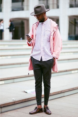 How to wear: pink raincoat, pink vertical striped long sleeve shirt, black chinos, dark brown leather oxford shoes