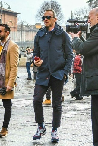Navy Raincoat Outfits For Men: You'll be surprised at how easy it is for any man to throw together this casual ensemble. Just a navy raincoat and dark brown chinos. For a more casual twist, introduce a pair of white and red and navy athletic shoes to the mix.