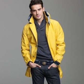 How to wear: yellow raincoat, charcoal shawl-neck sweater, navy horizontal striped long sleeve henley shirt, navy jeans