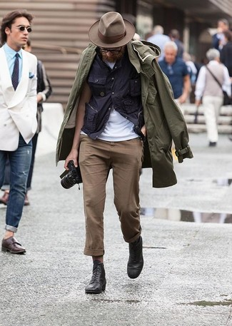 If you're looking for a casual yet stylish ensemble, consider teaming an olive raincoat with brown chinos. Both pieces are totally comfortable and will look great paired together. Amp up the cool of your getup by wearing black leather casual boots.