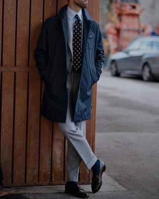 Grey Suit Outfits: We're loving the way this combo of a grey suit and a navy raincoat immediately makes men look elegant and smart. A cool pair of dark brown leather loafers is the most effective way to punch up this getup.