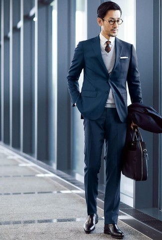 How to Wear a Teal Suit: This refined combo of a teal suit and a navy raincoat is a must-try getup for any man. Add black leather chelsea boots to this getup and you're all done and looking dashing.