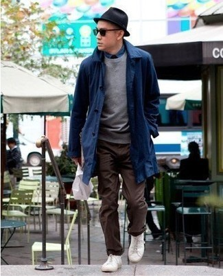 Bucket Hat Outfits For Men: We're all looking for comfort when it comes to styling, and this edgy pairing of a navy raincoat and a bucket hat is a great illustration of that. Bump up your ensemble by finishing with a pair of white canvas low top sneakers.