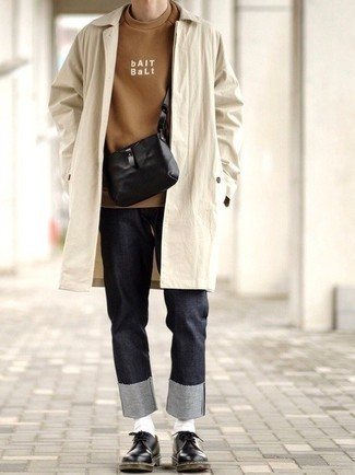 Charcoal Jeans Outfits For Men: If you're in search of a casual yet dapper ensemble, consider teaming a beige raincoat with charcoal jeans. Put an elegant spin on your outfit by finishing with black leather derby shoes.